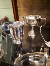 Two silver trophies.