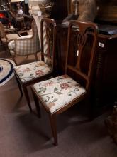 Pair of Edwardian inlaid mahogany chairs.