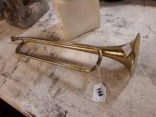 Brass bugle.