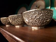 Three 19th. C. engraved white metal Oriental drinking bowls, with seal on b