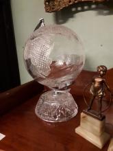 Cut glass globe on stand.