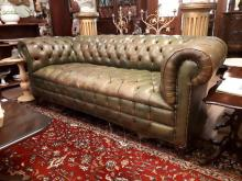 20th. C. hand dyed leather upholstered chesterfield couch raised on turned