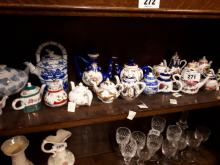 Large collection of miniature ceramic teapots.