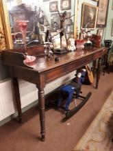 Georgian mahogany server with gallery back and raised on turned legs. { 92c