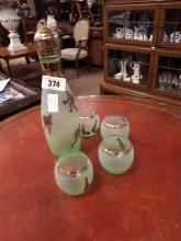 Art Deco green glass decanter decorated with skittles with four matching gl