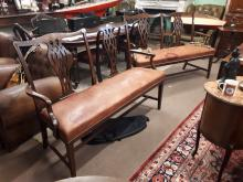 Pair of exceptional quality Edwardian mahogany benches with leather upholst