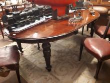 William IV. Mahogany dining room table raised on turned legs with acanthus