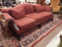 Irish Georgian upholstered mahogany camel backed sofa.