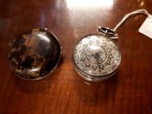 1690's pocket watch the tortoise shell back engraved with a hunting scene.