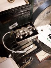 White metal pill box.
