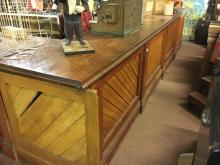 Late 19th. C. shop counter with mahogany top and pine base with inset herri