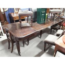 Regency mahogany dining room economy table supported by six reeded legs, ex