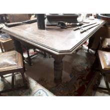 Edwardian oak dining room table on reeded legs.