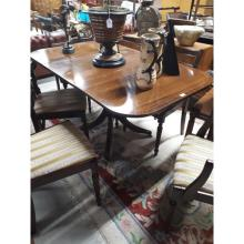 Regency style inlaid mahogany dining table with four outswept feet. (150 cm
