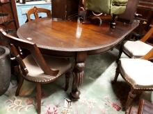 Edwardian mahogany dining room table on carved legs.