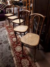 Set of twelve bentwood chairs with bergere seats.