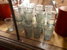 Collection of thirty ½ pint green drinking glasses.