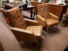 Pair of 1960's leather upholstered armchairs.