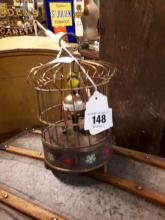Automaton clock bird in a cage.