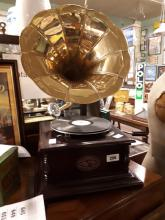 Gramophone with brass horn.