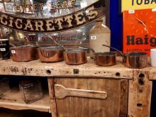 Set of five graduating Georgian copper and metal saucepans.