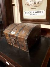 Wooden metal bound storage trunk in the Tudor style.