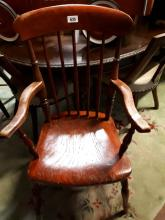 19th C. pine kitchen arm chair on turned legs.