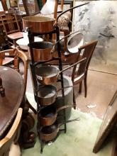 Selection of 19th C. copper saucepans and iron stand.