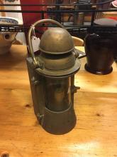 Brass ship's lamp.