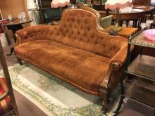 Victorian inlaid walnut sofa on turned legs.