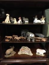 Three shelves  - Misc. lot of carved wooden animals and ceramic animals.