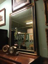 Ebonized gilt mirror with bevelled plate. { 139cm H X 114cm H }.