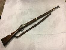 19th. C. percussion capped musket with original leather strap.