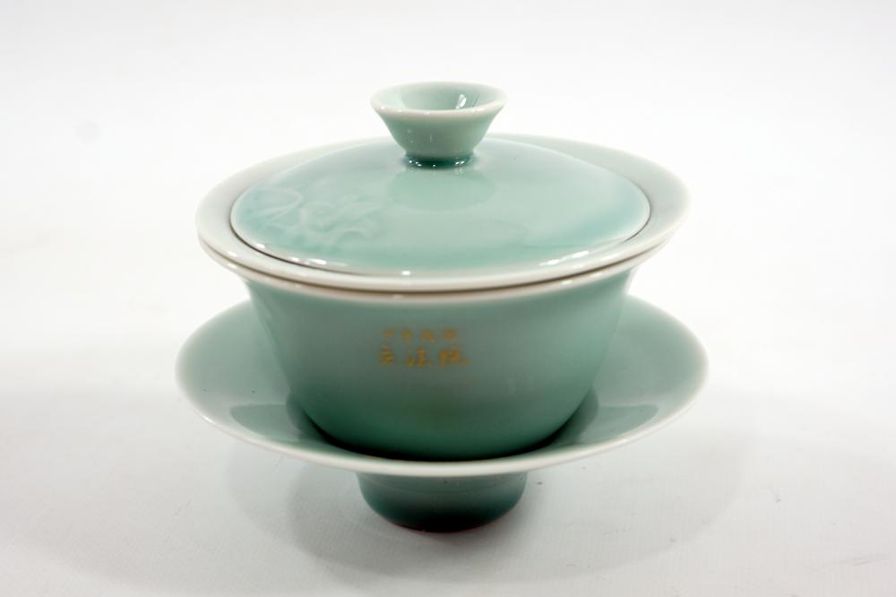 A cup of Korean porcelain for drinking tea sealed in an original 10 cm high box