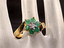 Jewelry.  Gold over Sterling Emerald Flower ring.