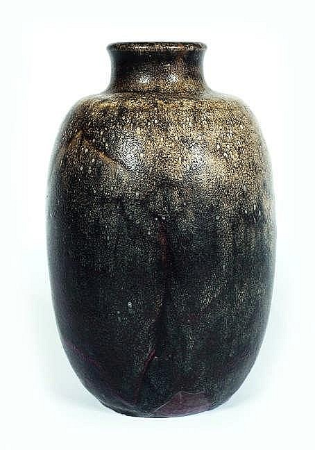 A grey and brown glazed ceramic vase