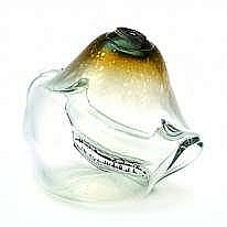 A clear glass object with green rim