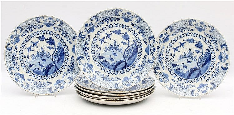 A series of eight Delftware plates with decor of ducks in a land