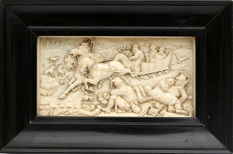 An ivory plaque with a troijka running through a snowy landscape