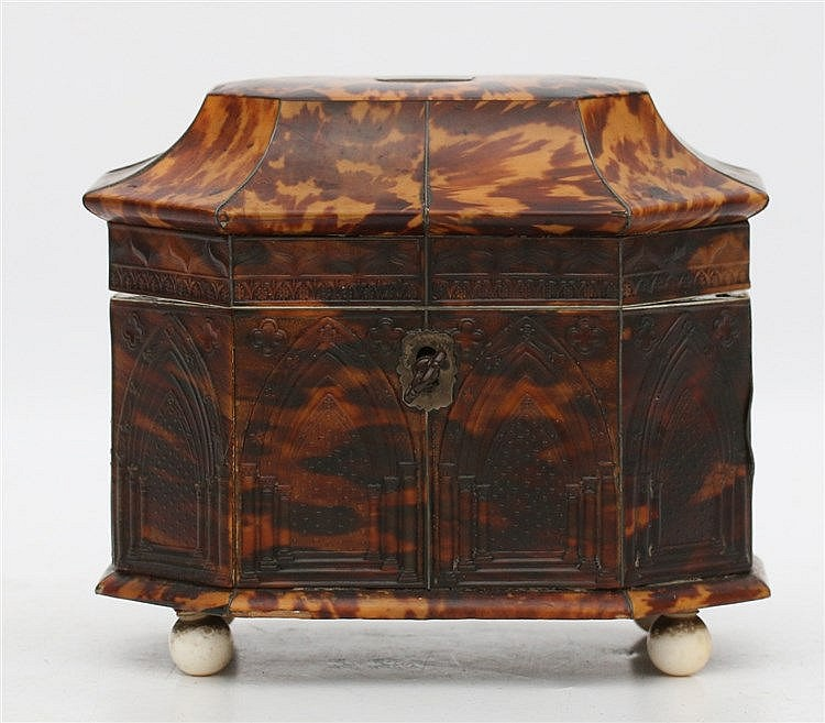 A pressed tortoise shell teacaddy. Decorated with a Neo-Gothic c