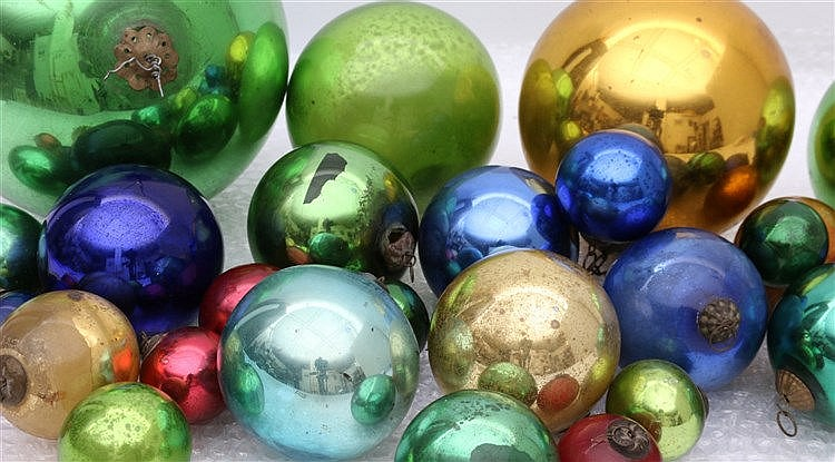 A collection of 25 coloured glass 'Kugels'. 19th century and lat