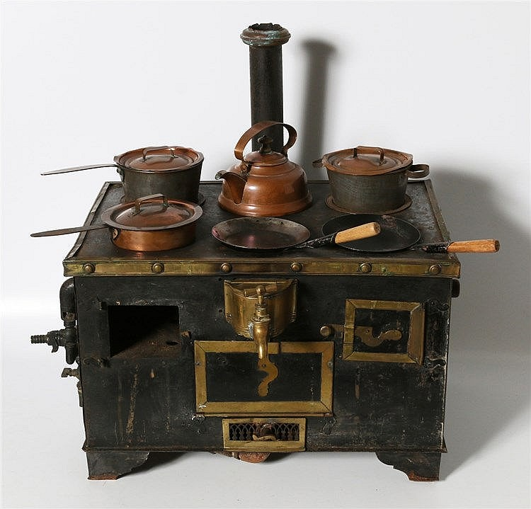 A metal children's stove with attachments. Late 19th century. Mi