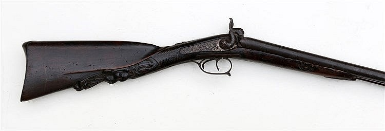 A double-barreled rifle, the handle carved with lions. Belgium,