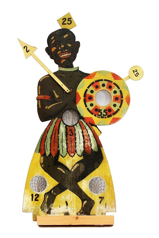 A wooden ball game in the shape of an African warrior. First hal