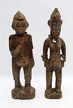 Two wooden twin figures with beads and shells, Ire Ibeji. Yoroba