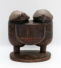 A wooden double oracle pot, the lids in the shape of stylised bi