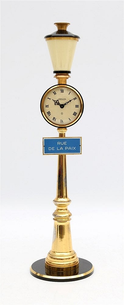 Jaeger Rue de la Paix, a gilt metal table clock shaped like a str
