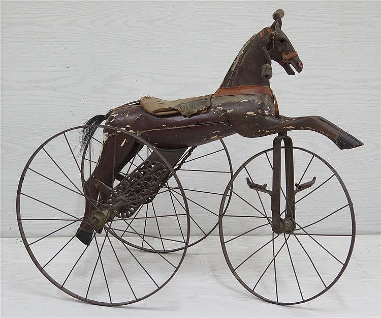 A wrought iron and wooden polychrome pony cycle. France, first h