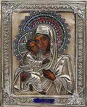 A Russian Icon with part enamelled silver riza. Mother of God. 1
