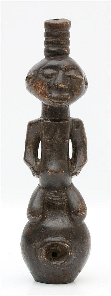 A wooden pipe in the shape of a kneeling woman, Luba tribe, Cong